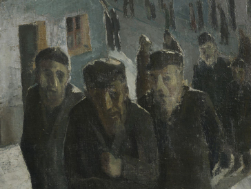 People on a street, in the foreground are three older, bearded men in coats with hats