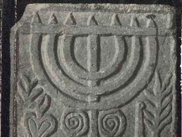 Detail from a book cover: Illustration of a menorah stone relief