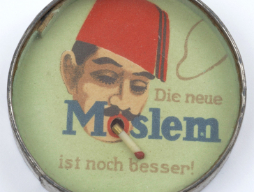 Round container with an image of a man wearing a Fez hat smoking a plastic cigarette