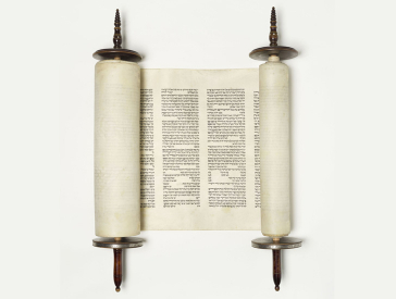 Torah scroll: it is slightly rolled up so that two columns of Hebrew text are visible