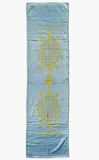 Rectangular cloth made of light-blue silk with an inscription and ornaments embroidered in yellow
