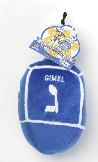 Blue dreidel made of stuffed plush from the brand V.I.P. (VERY IMPORTANT PET); the Hebrew letters nun, gimmel, he, and shin are embroidered on the sides