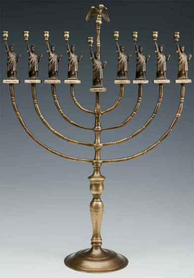 Candelabrum with a round base fitted to a central stem from which eight branches extend, four on either side, each of them topped with a miniature Statue of Liberty