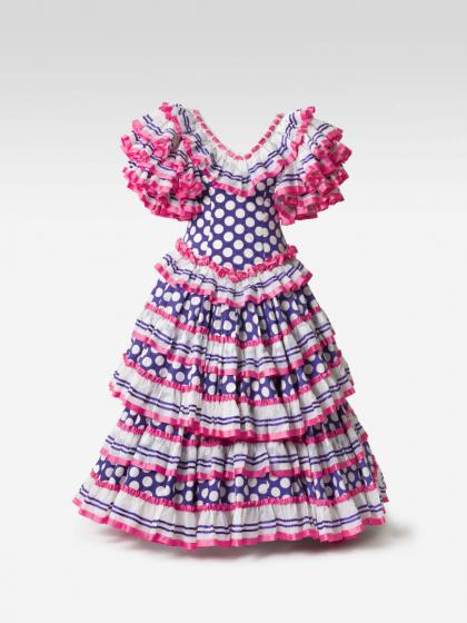 Blaues Kleid mit weißen Punkten und pink, blau und weißen Rüschen