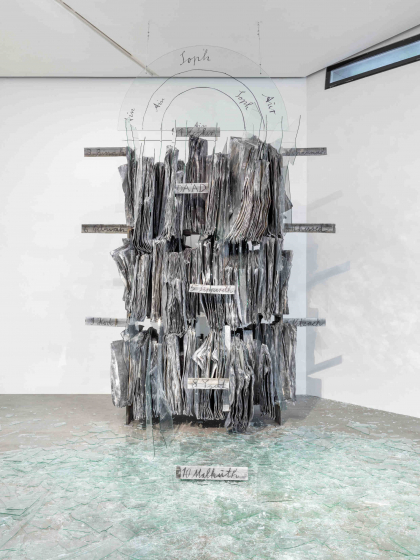sculpture made of metal and glass, shards on the floor