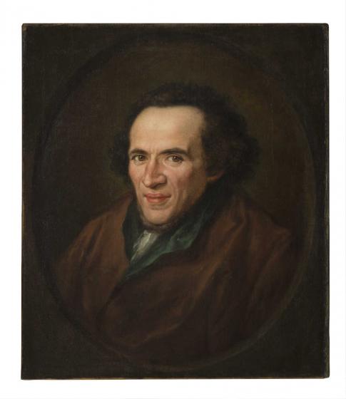 Ölgemälde in vergoldetem Rahmen: Portät von Moses Mendelssohn im Halbprofil in einem gemalten ovalen Rahmen dargestellt, die Augen sind auf die Betrachtenden gerichtet.