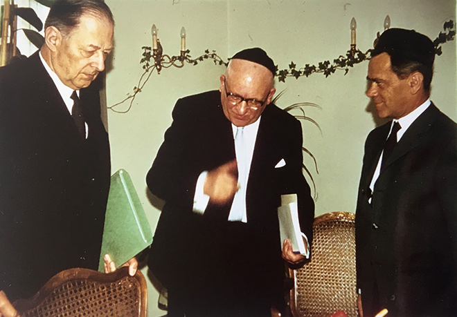Photograph of three men in suits and kippot