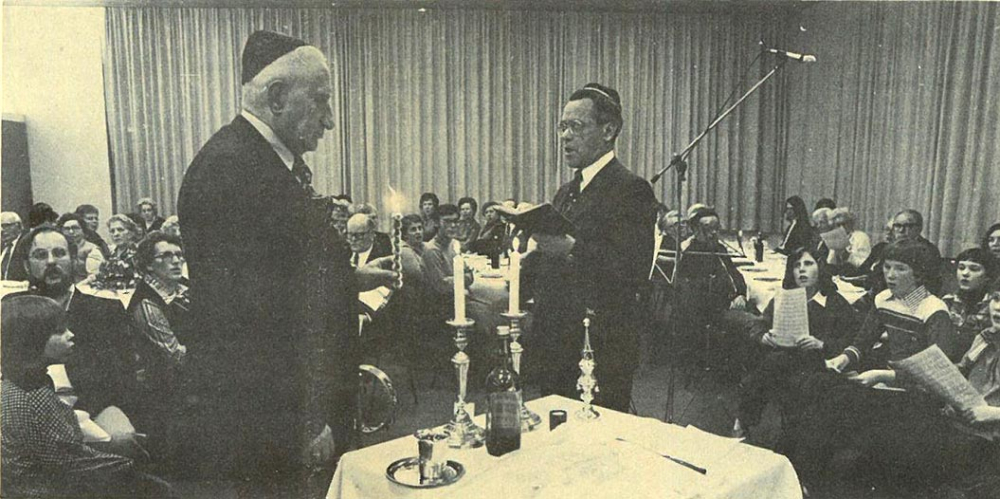 Black-and-white photograph of a festive Shabbat ceremony