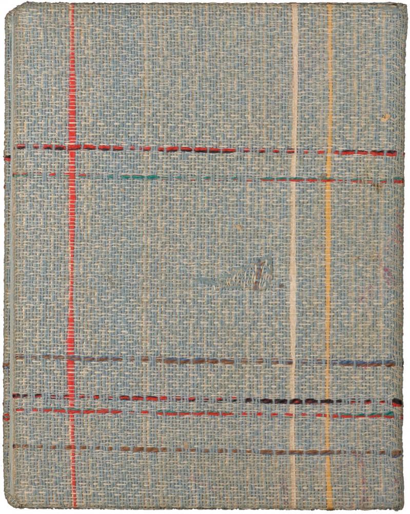 Rückseite eines Notizbüchleins mit kariertem Textileinband