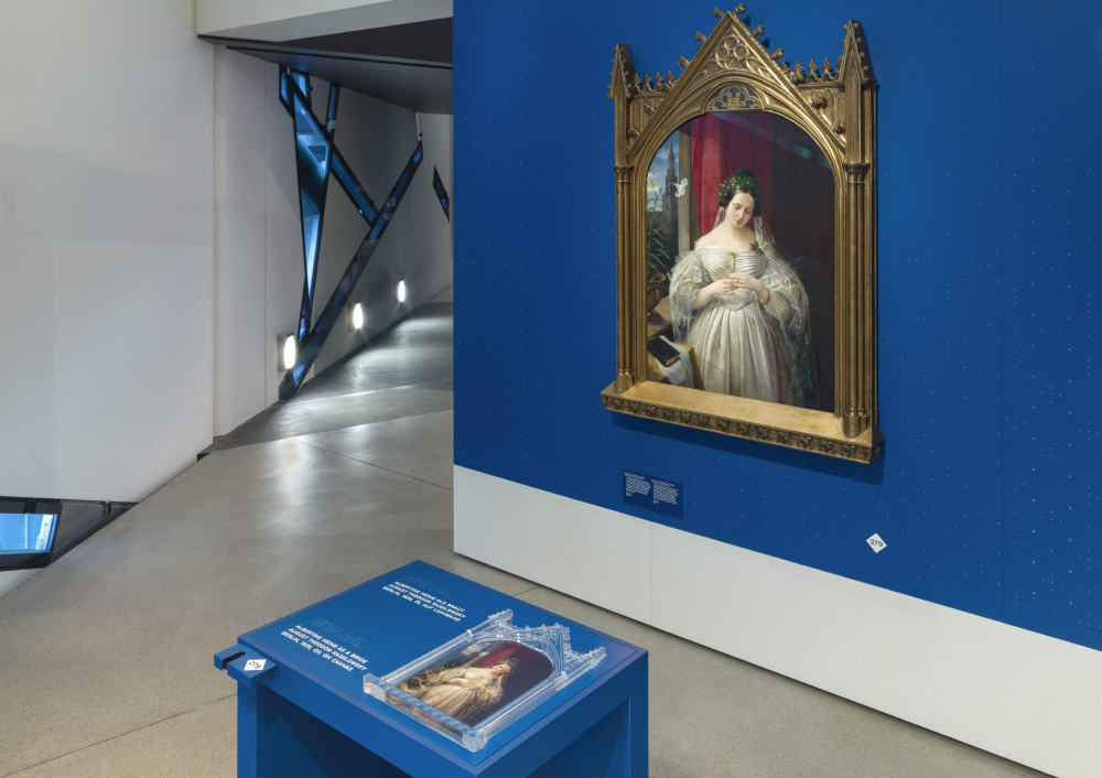 View into the exhibition with painting and media station