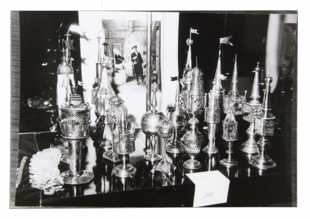 Black and white photograph with Besamim cans in a showcase