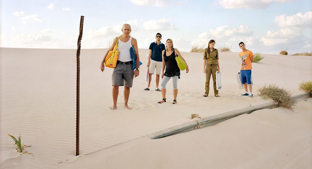 Family walking through the desert