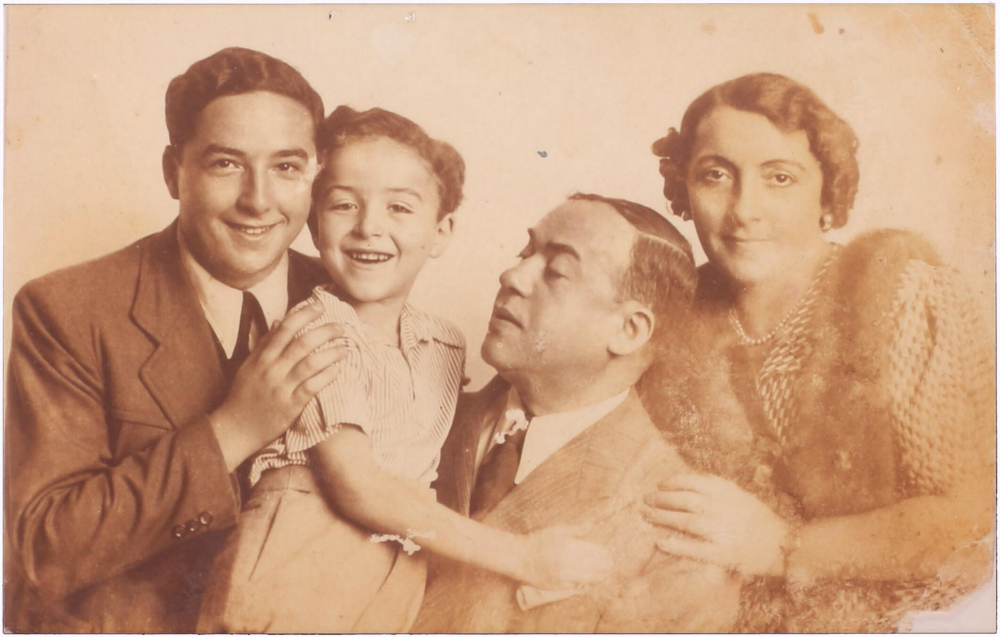 sepia-tone family photograph Husband and wife with one adult son and one school-aged son