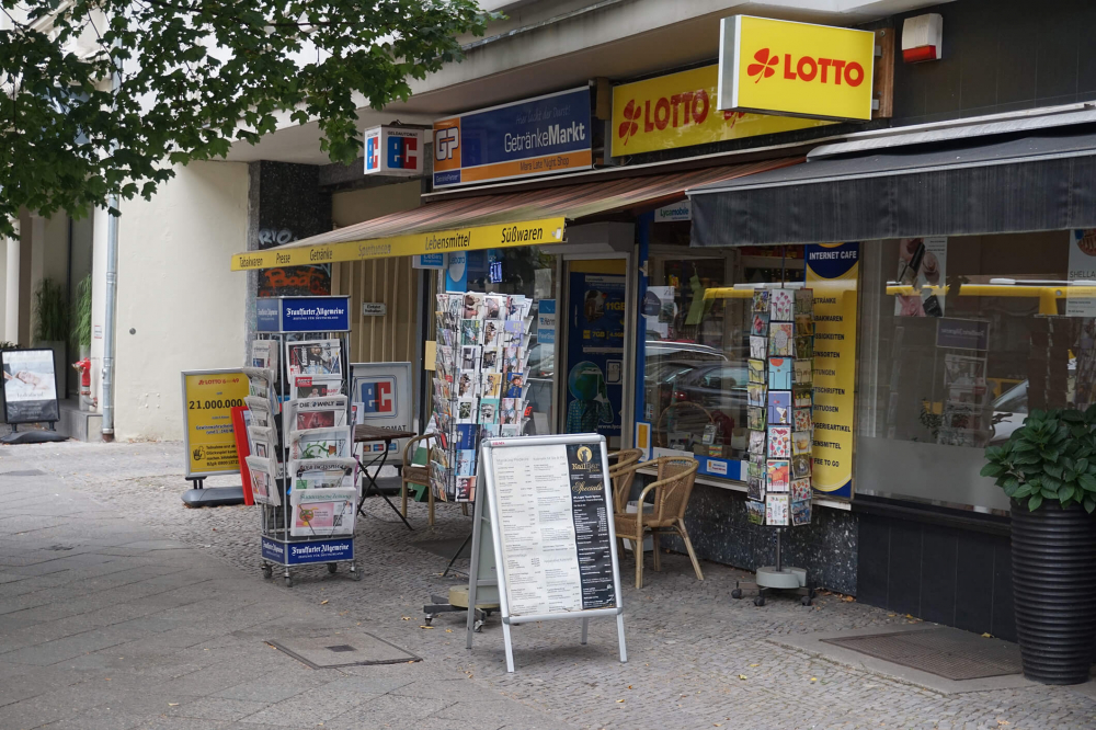 Color photo: Convenience store with awning and signage