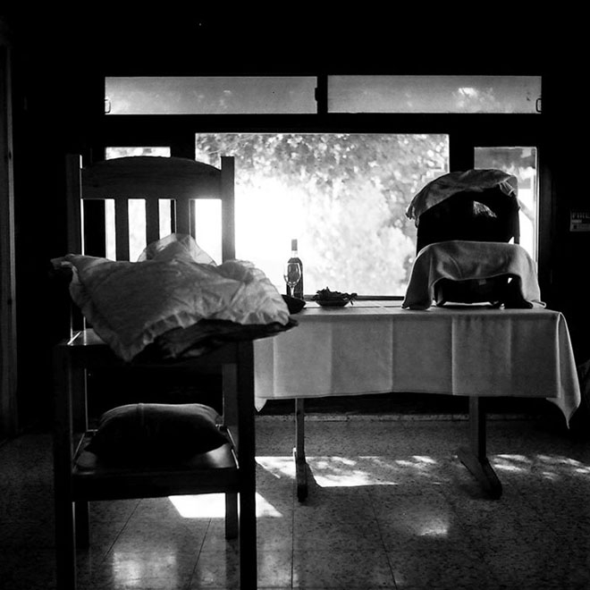 Black and white photography: The godfather' chair and the infant carrier with Yair