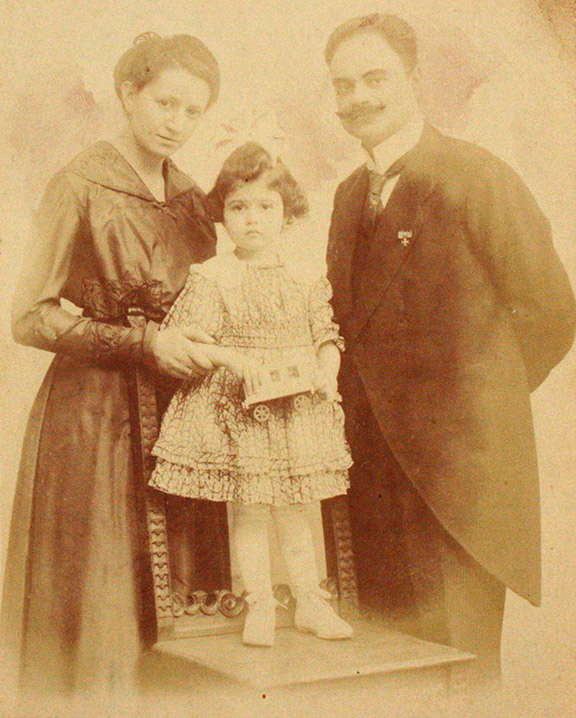 Studio portrait of a woman and a man with a child, about four years old