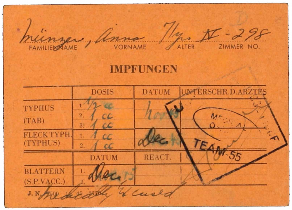 Vaccine certificate for Anna Münzer from the DP camp, with a partly legible stamp from the medical office