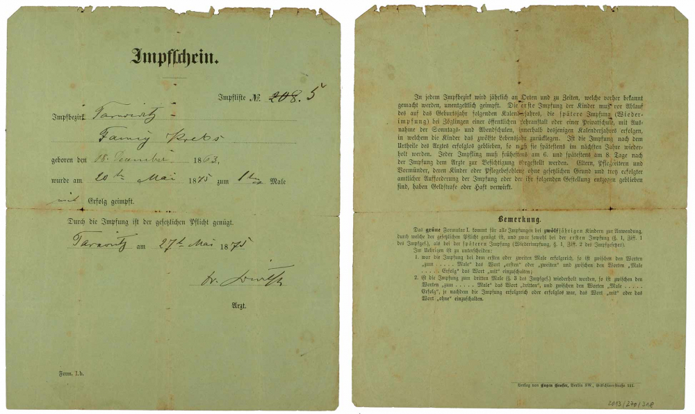 Front and back of the vaccine certificate for Fanny Krebs, smallpox vaccine, fillet out by hand, Tarnowitz, 20 May 1875.