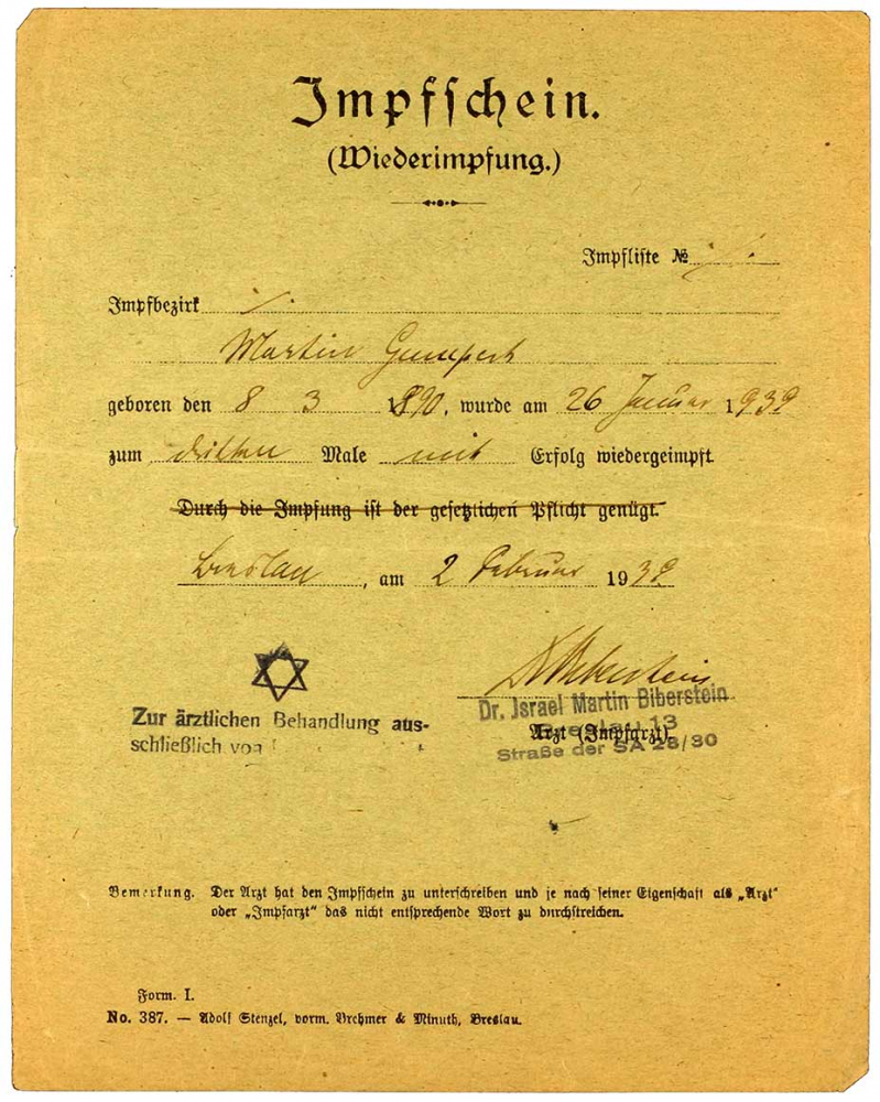 Vaccine certificate for Martin Gumpert with an imposed middle name added in, Breslau, 1 Feb 1939.  The vaccine certificate bears a stamp indicating that the physician, Dr. Martin Biberstein, is authorized to treat Jewish patients exclusively.