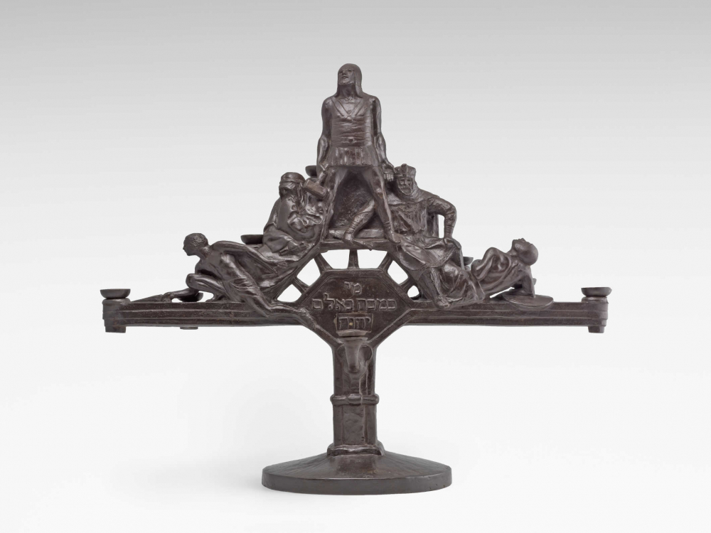 Metal candlesticks with figures and Hebrew script