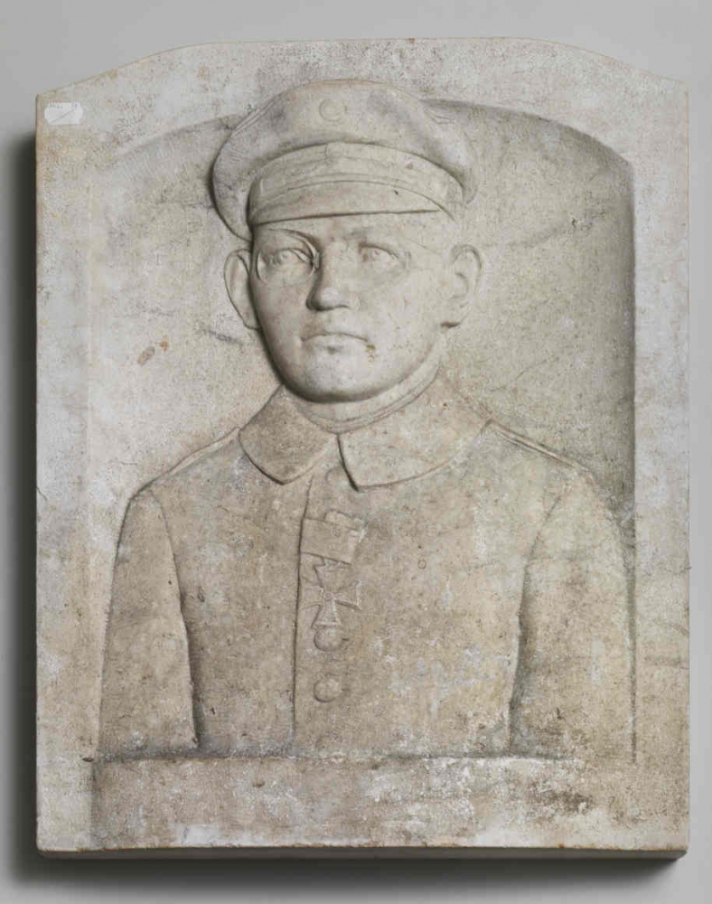 Portrait carved in stone of a man in uniform