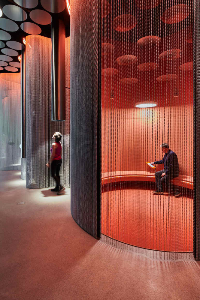 View sound room with metal curtains and people