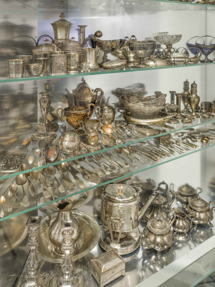 Shelf with silver items