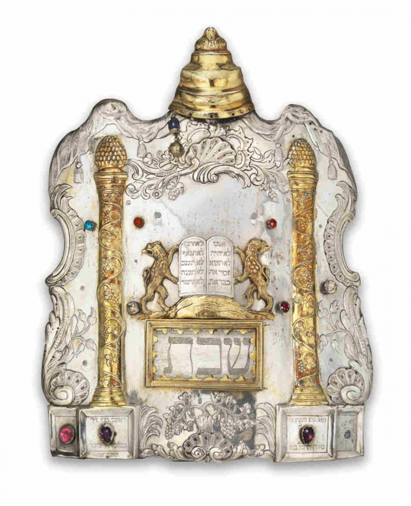 Torah shield made of stone decorated with gold and colorful stones