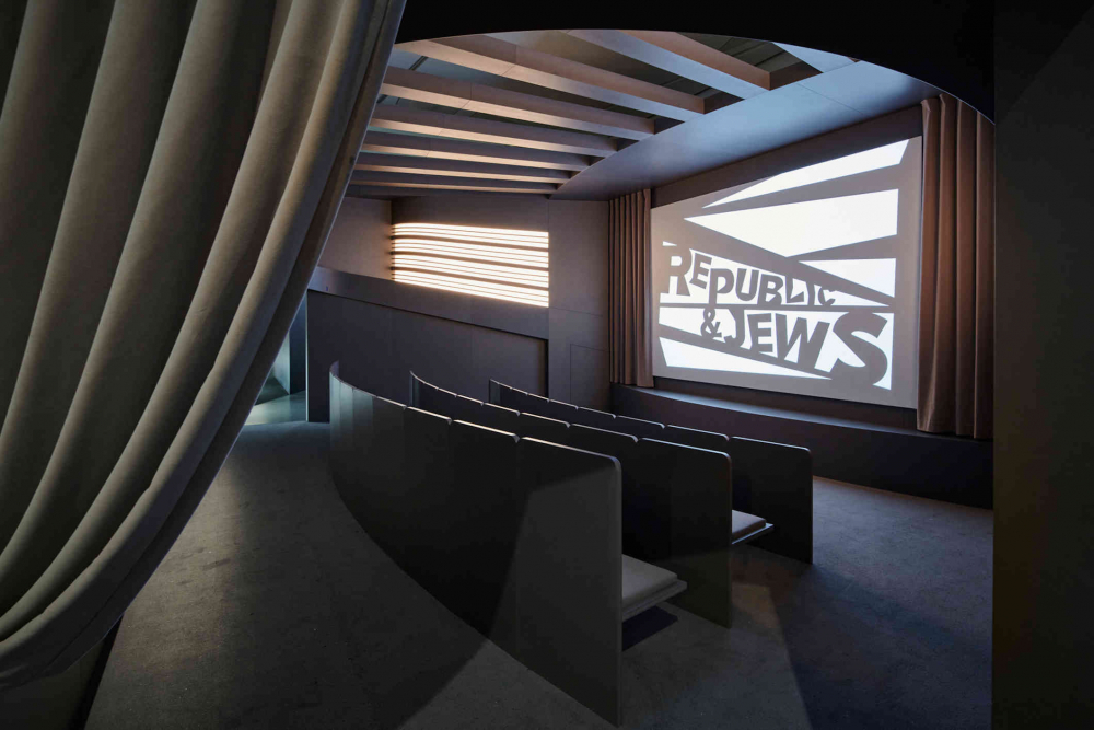 cinema hall with three rows, on the screen stands Republic & Jews