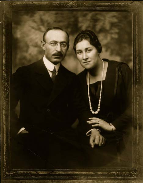 Portrait of Bernhard and Paula Lustig, taken in a studio, both looking into the camera