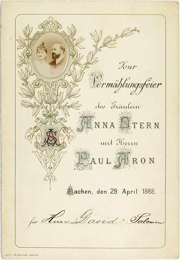 Invitation card with flower ornaments and a photograph of the bridal couple