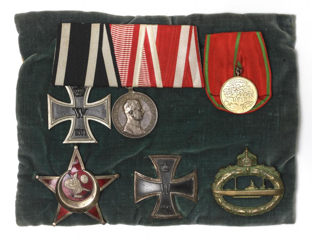 Six military medals on a velvet cushion
