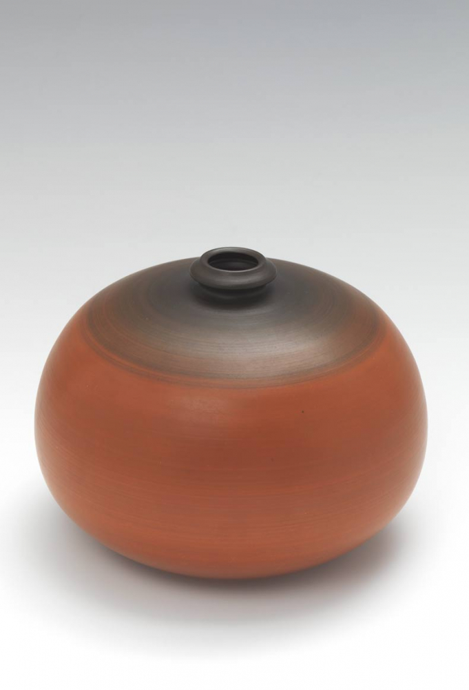 Orang and brown spherical vase with a small opening