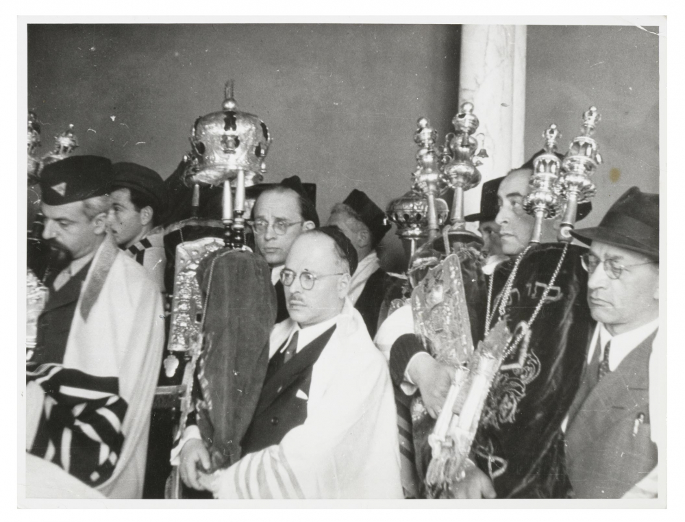 Black-and-white photograph of a group of people at the reconsecration of a synagogue