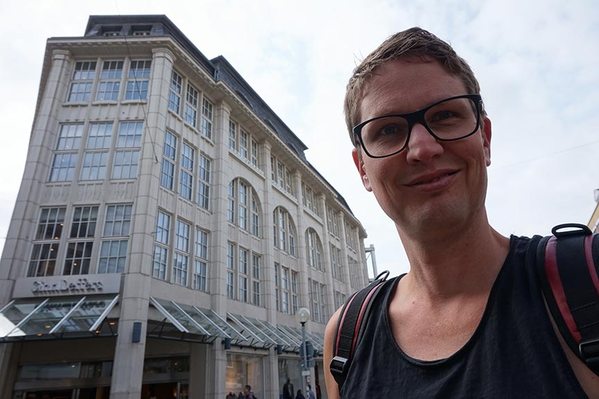 Selfie with department store in the background