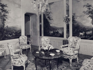 Black and white photo of a room with ornate furniture and landscape paintings on the walls.