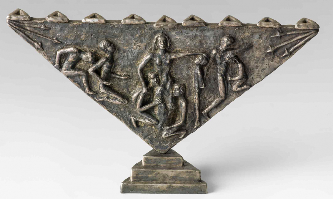 Bronze candelabrum in the shape of a triangle balancing on one point. Reliefs on the side portray a woman and seven men cowering, lamenting, and mourning. The depiction is based on the martyrdom story of Channa and her seven sons.