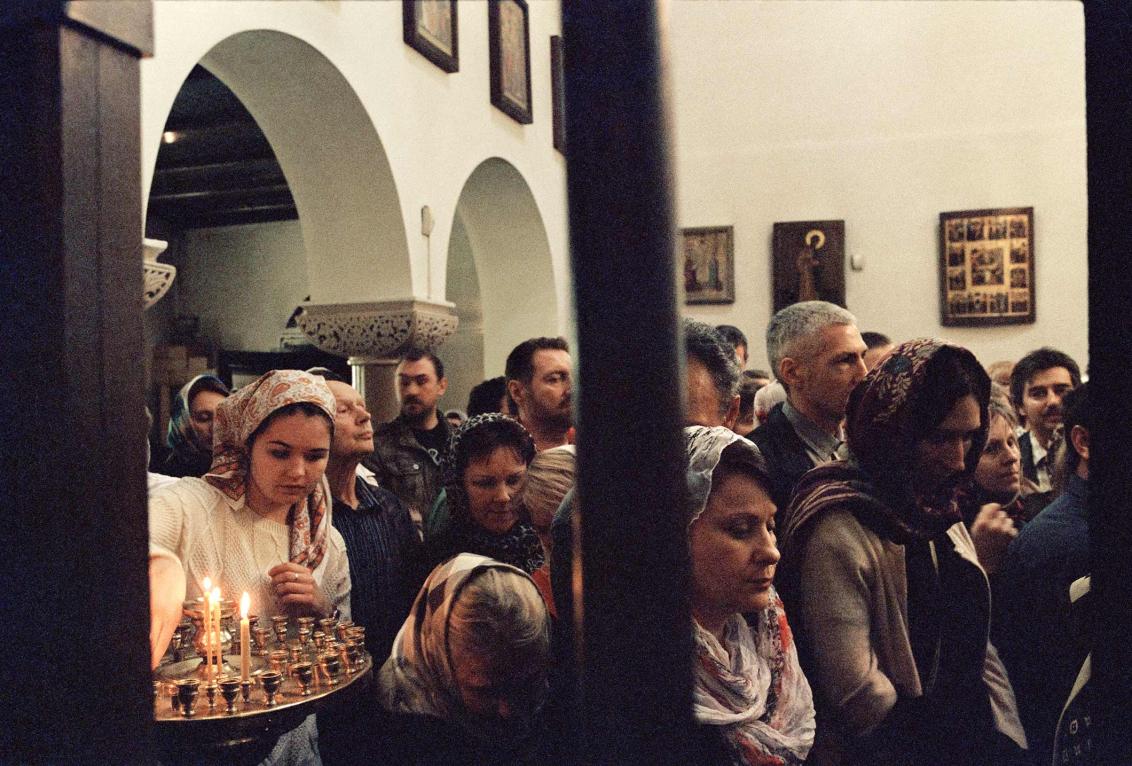 Women wearing kerchiefs in the nave of a church