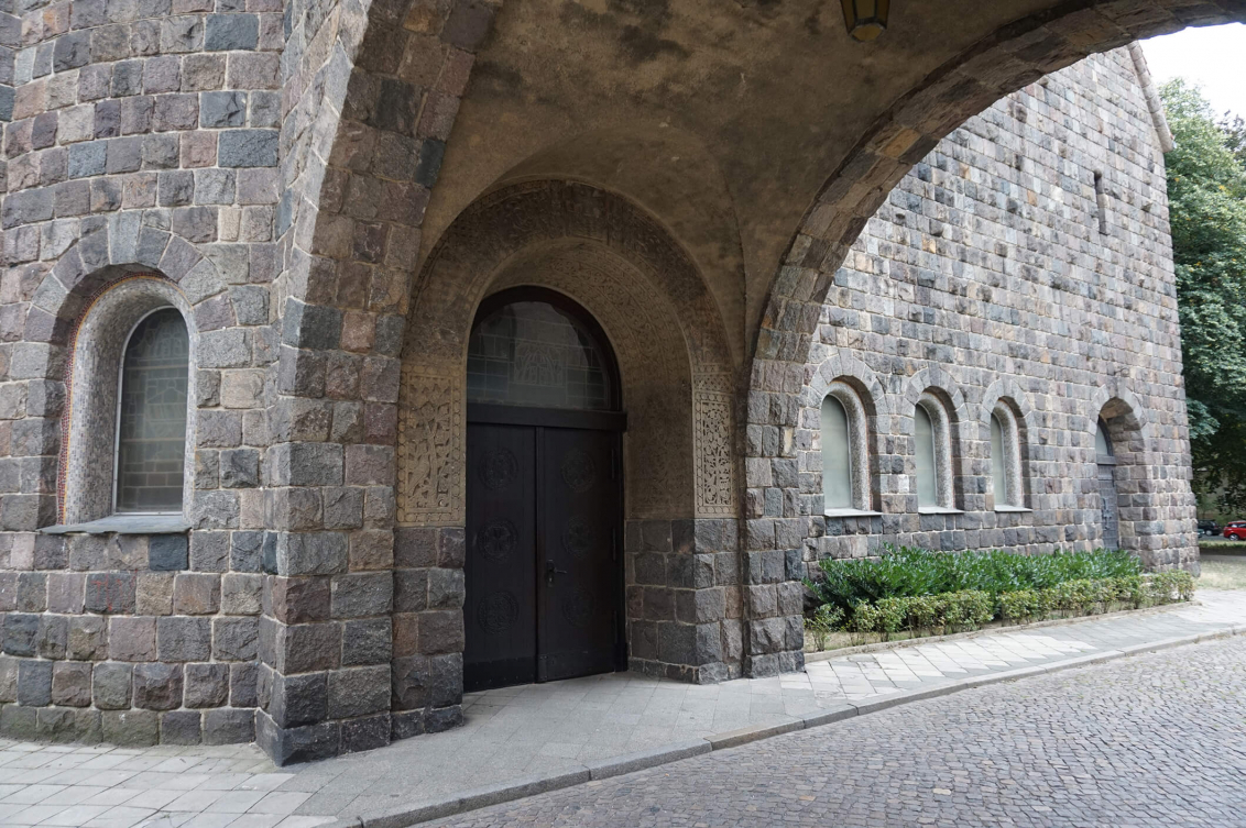 Color photo: Granite gateway to a neo-Romanesque church