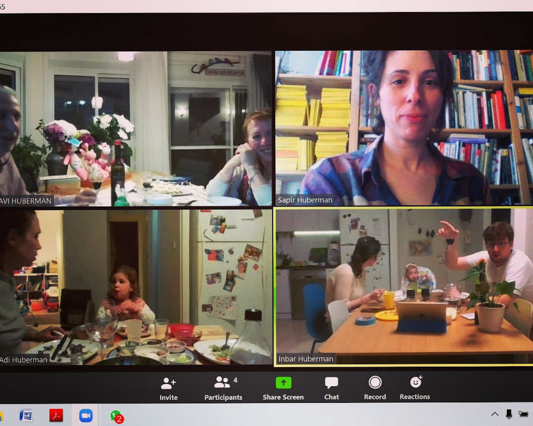 Screenshot of a video chat with four windows in which people can be seen.