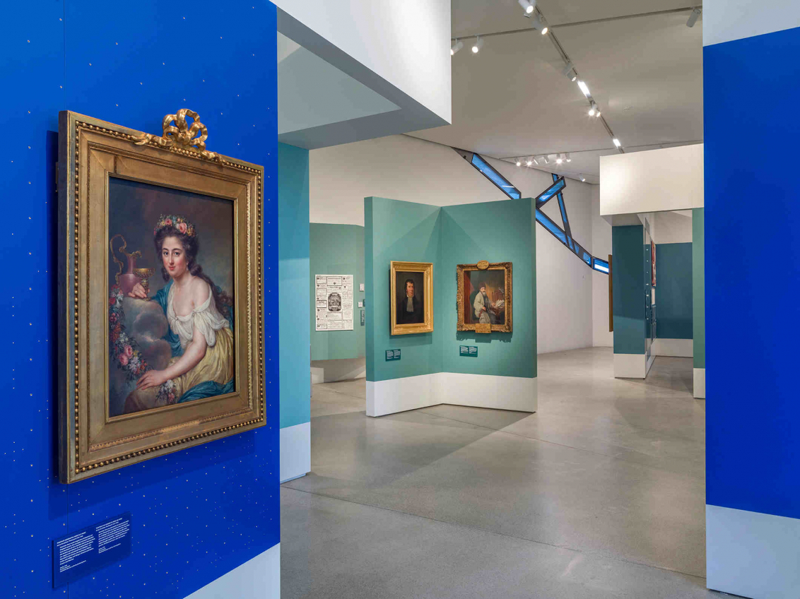 View of paintings on blue and turquoise walls