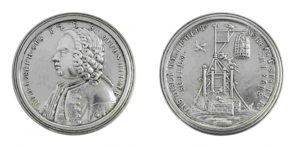 Zwei Seiten einer silbernen Medaille