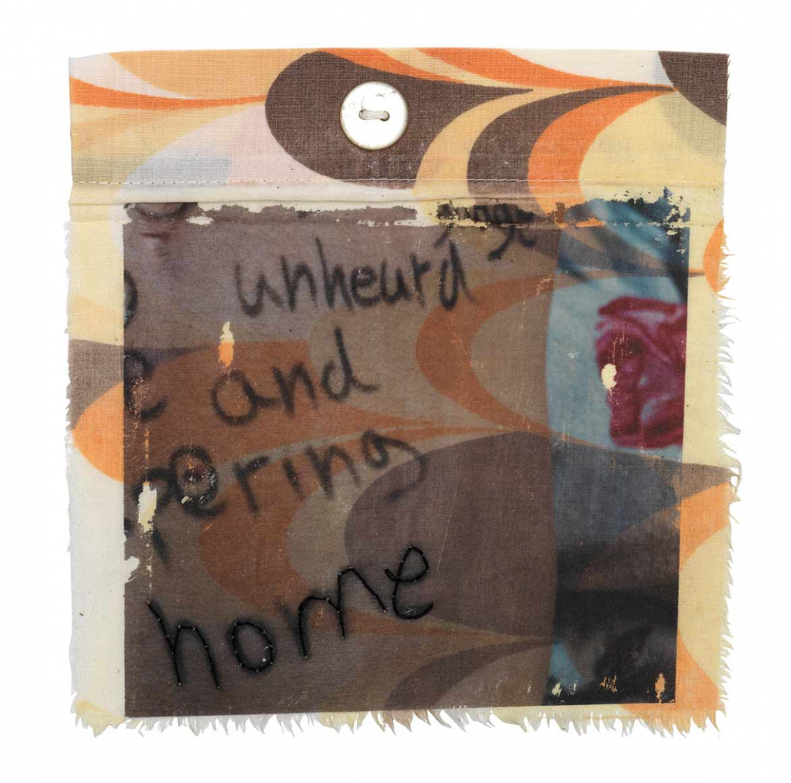 """Nearly square piece of fabric from a used duvet cover with fraying edges and a multicolored """"swoop"""" pattern with English words written on it, including the word """"home"""" traced over in thread"""