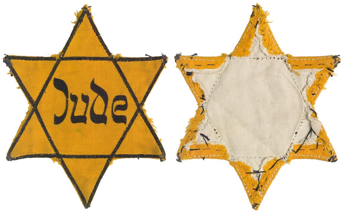 Aufnäher eines gelben, sechszackigen Sterns mit der Aufschrift