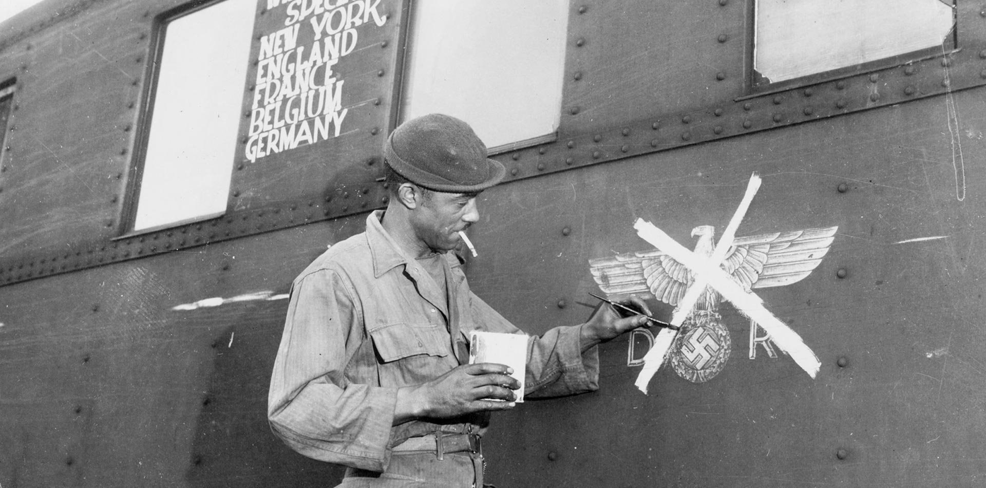 A man is painting on a waggon