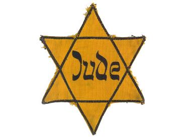 """Sechszackiger gelber Stern mit der Aufschrift """"Jude"""""""