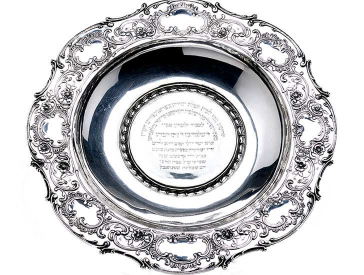 Silver washbasin with flowers and ornaments, in the middle a Hebrew inscription