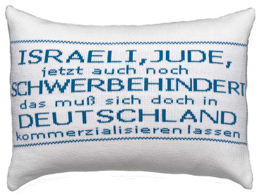 White pillow with blue script