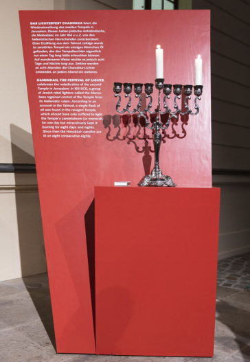 Chanukah candelabra with two burning candles
