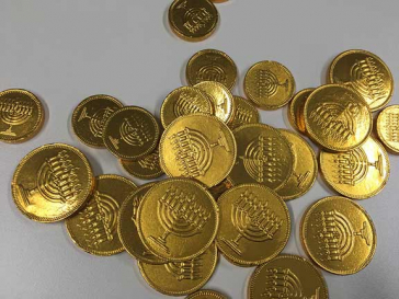 Chocolate coins. These are wrapped in shiny golden foil embossed with Hanukkah lamps